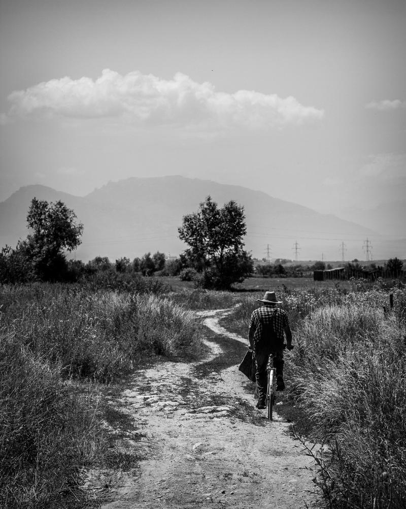 Old man on a bike by JoeGP