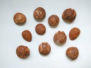 Avocado seed carvings