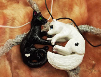 Black and white - cat and arctic fox by AlviaAlcedo