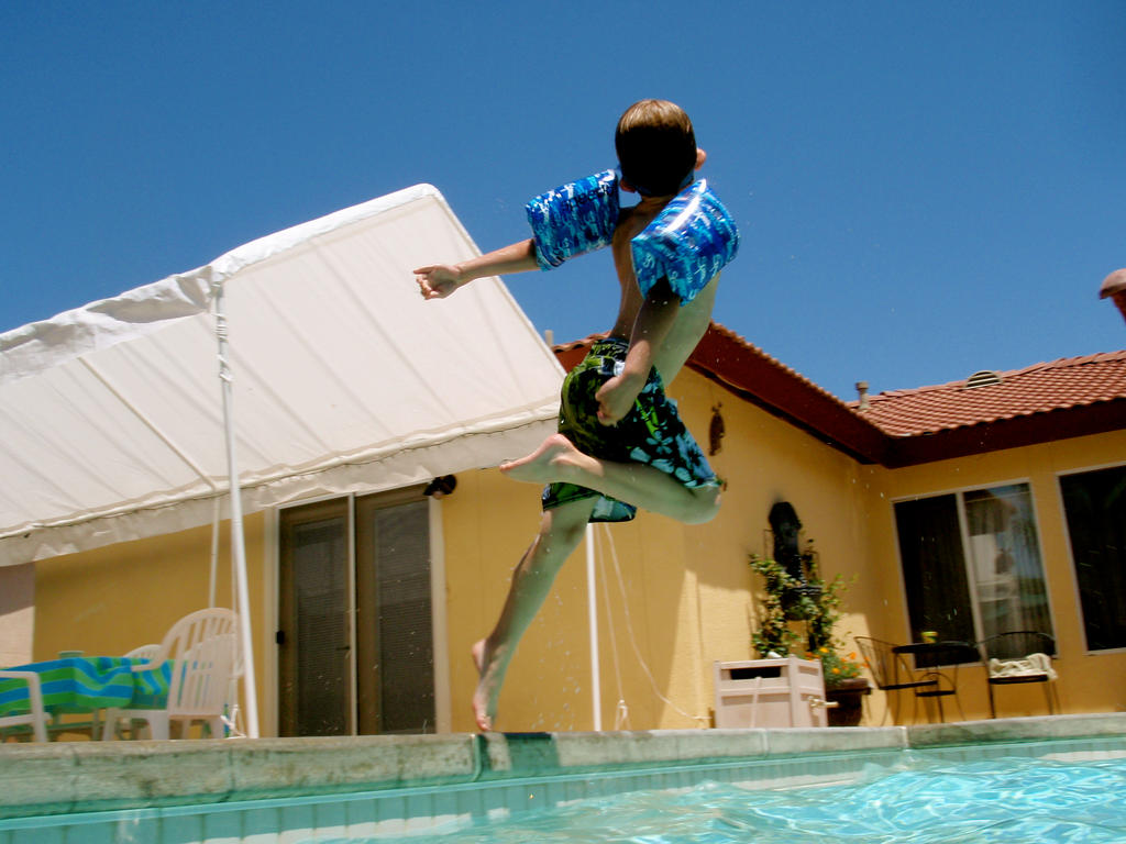 Kid Dive Into Pool Kid Jumping Into Pool by