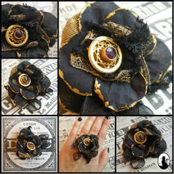 Black and gold ring with a tiny antic Amethyst