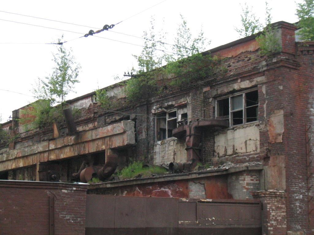 http://img02.deviantart.net/baff/i/2006/105/6/0/abandoned_warehouse_by_minzastro.jpg