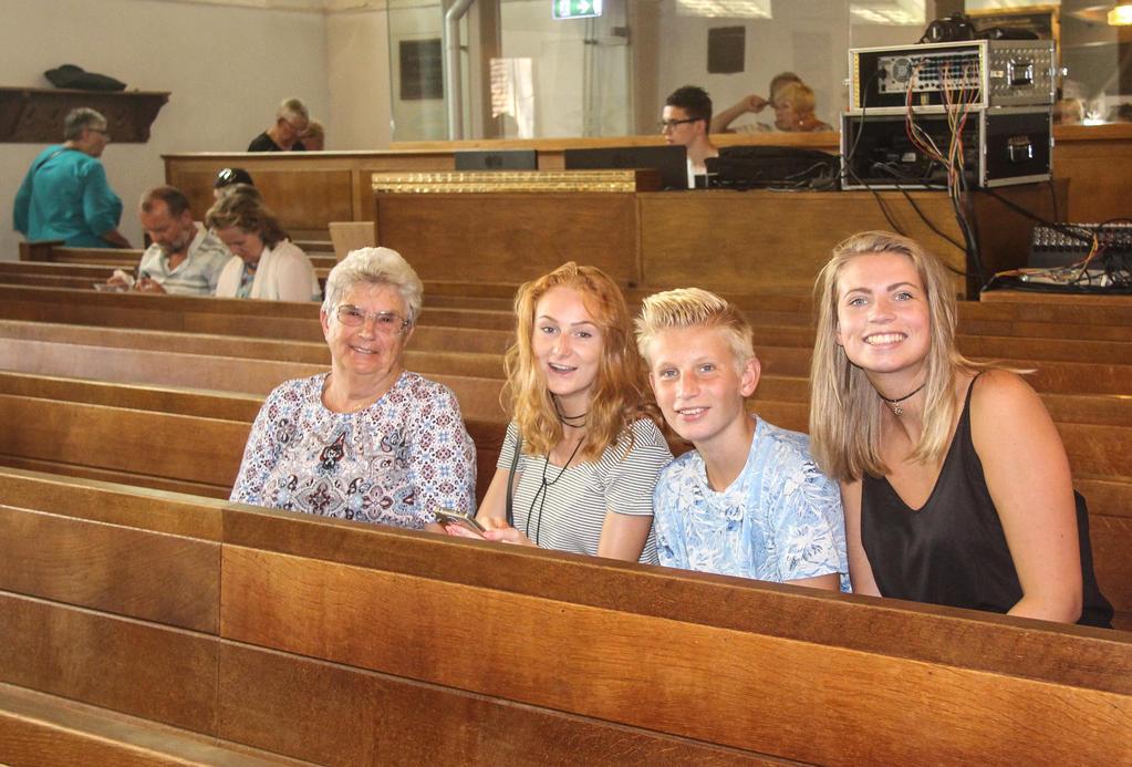 Laughing family in church by slingeraar