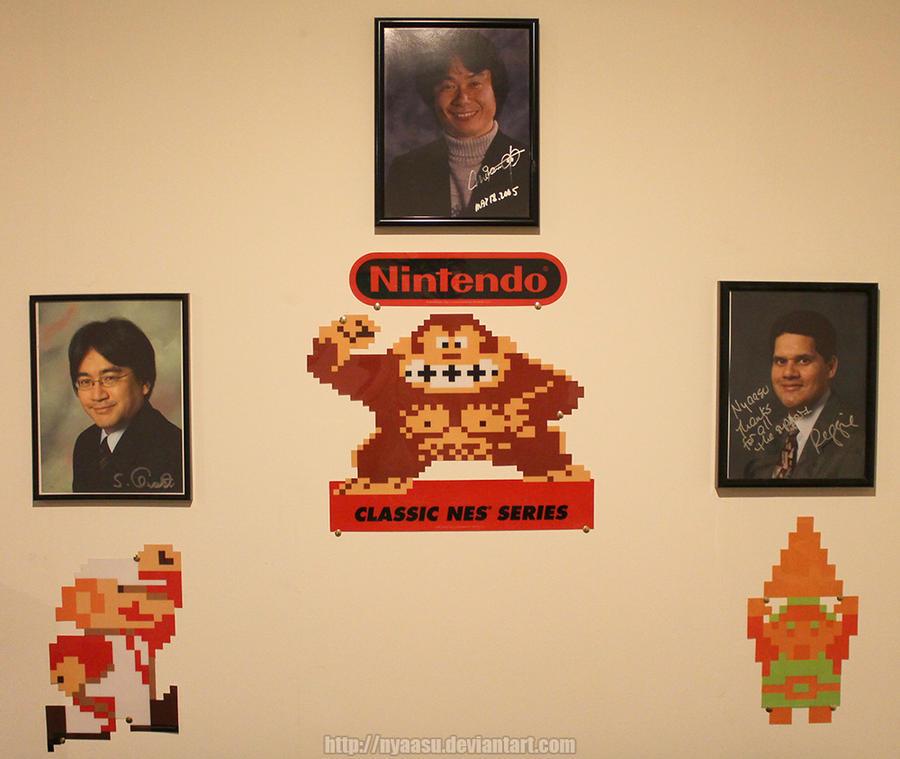 My Gameroom Wall - Miyamoto, Iwata, Reggie by Nyaasu on DeviantArt