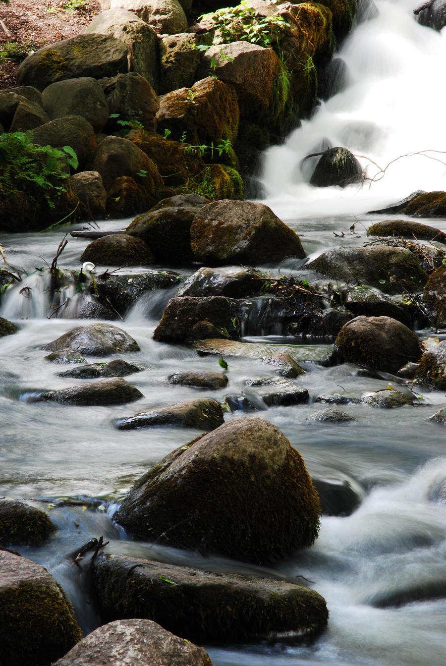 Waterfall and rocks by iisjahstock