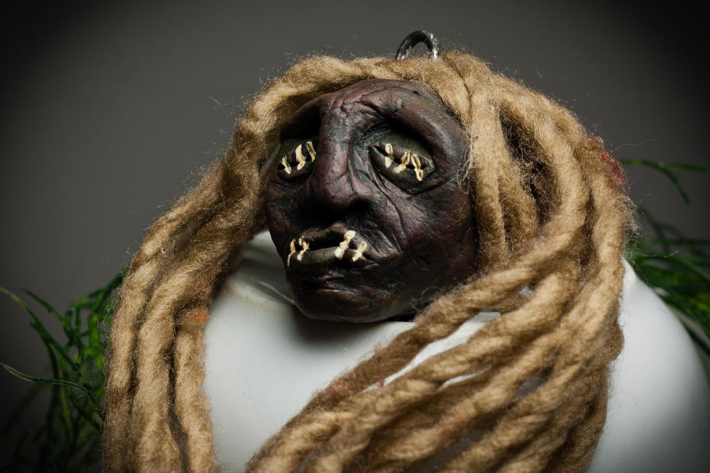 Shrunken Head with blond Dreads by SheevrasHain