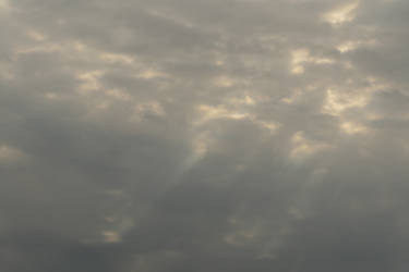 Sun rays through clouds onto clouds
