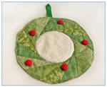Christmas wreath mini quilt by restlesswillow