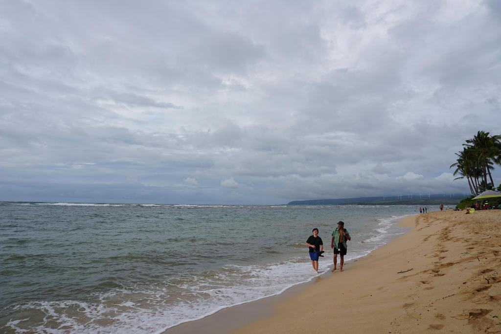 Hiking the beach by EllieZ