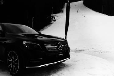 Black Mercedes in white snow