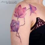 Freehand purple pink magnolia tattoo