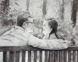 Couple in Black and White on a Bench