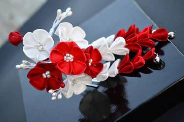 Modern Maiko: red and white ume kanzashi. by hanatsukuri