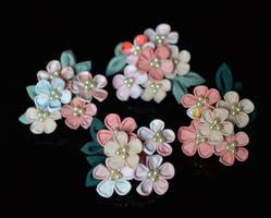 Pink kanzashi in a bob. Spring flowers