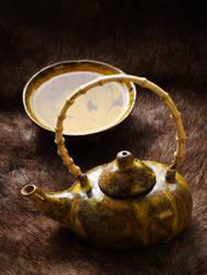 Yellow teapot by Mycelius