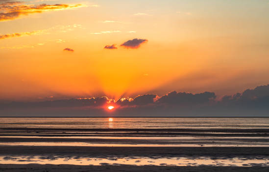 Low tide and sun