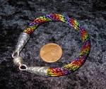 Rainbow Bracelet with Knotwork cones by Shiningstarofwinter