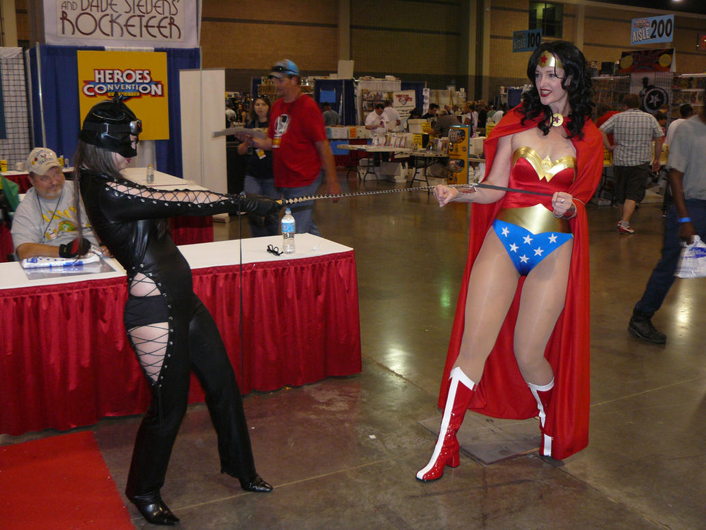 Catwoman ties up Wonder Woman by CatwomanofTheSouth