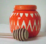 Pot bellied orange honey pot