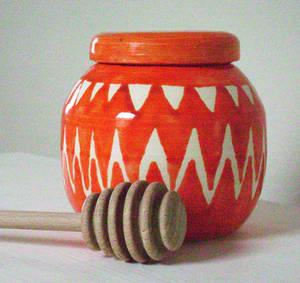 Pot bellied orange honey pot