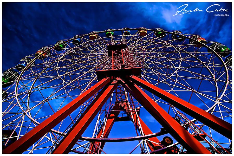 Ferris Fun under a storm by jaydoncabe