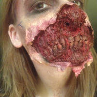 Ripped face zombie by Garnier-FX