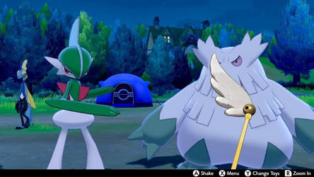 Abomasnow and Gallade playing with the toy