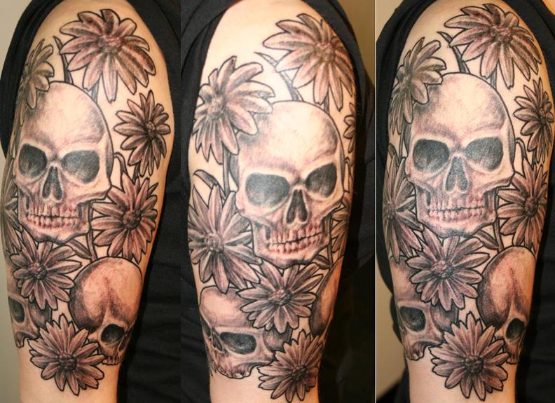 skulls and daisies - flower tattoo