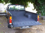 Truck Bed Repainted By Hand