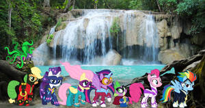 Power Ponies And Mane iac by a waterfall