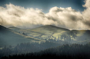 a glimpse of light among the clouds by Lk-Photography