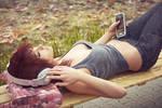 Relaxing on bench in headphones