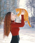 Holding the red cat