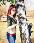 Leaning on birch tree