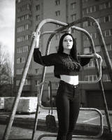 Leaning on climbing frame