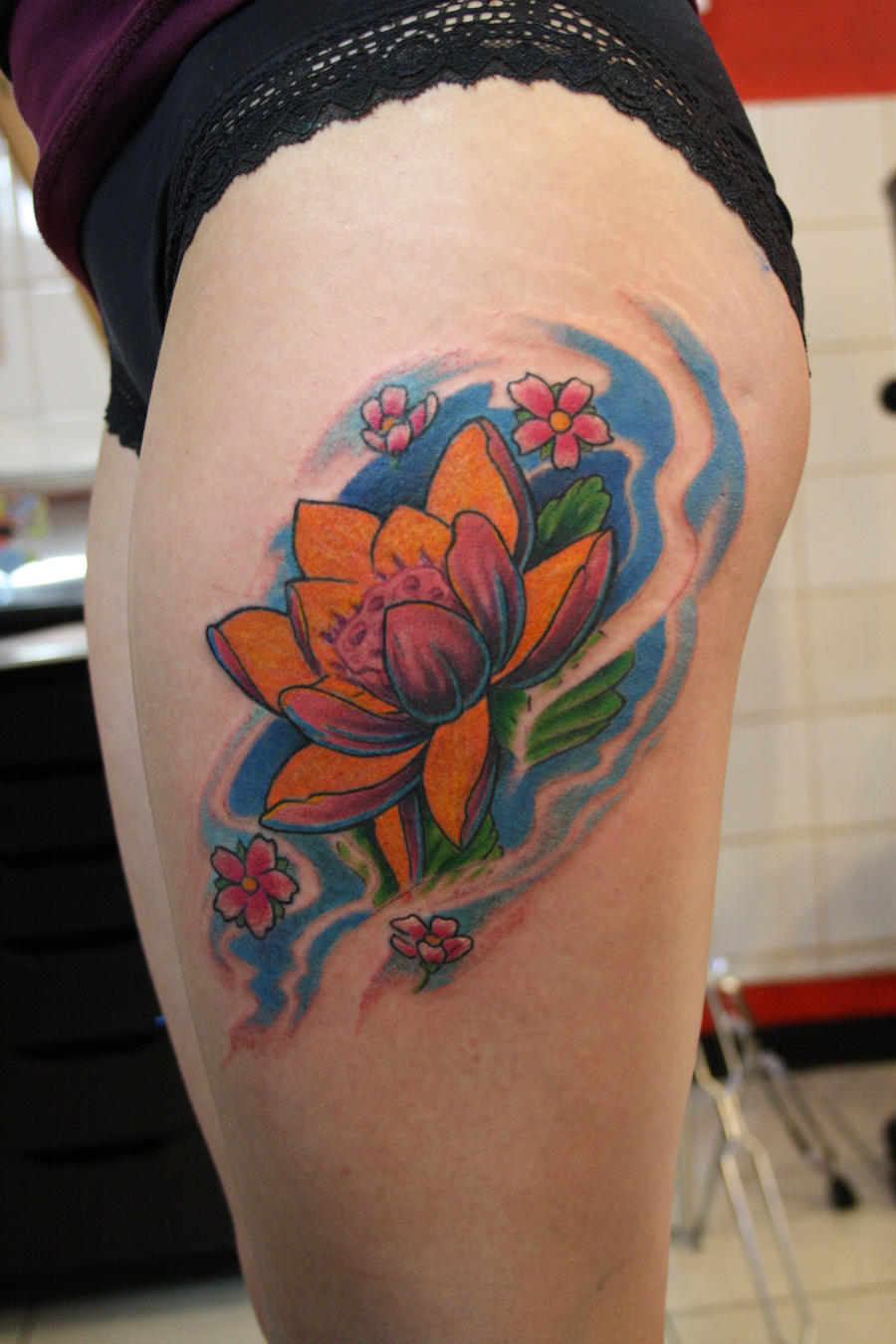 Lotus thigh by SimplyTattoo