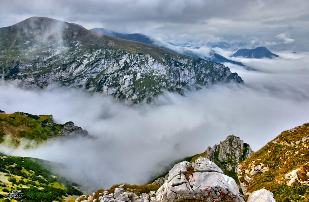 Mountains in the fog by miirex