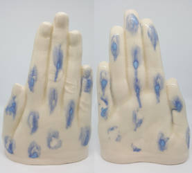 Ceramic Glazed Hand with Blue Spots by TeleviCat