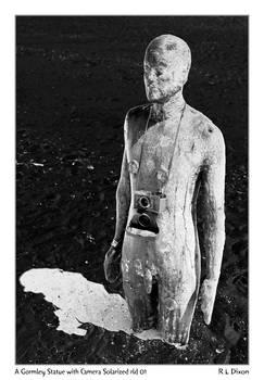 A Gormley Statue with camera solarized rld 01 dasm