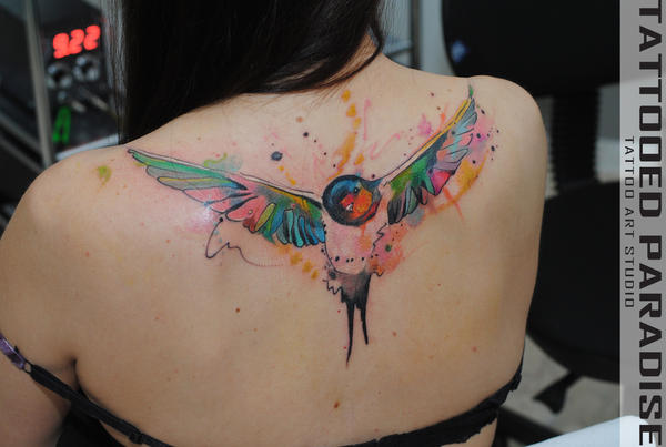 Watercolor sparrow tattoo