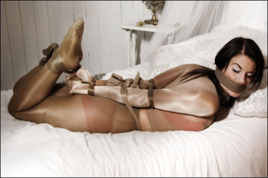 Girls bound and gagged with pantyhose