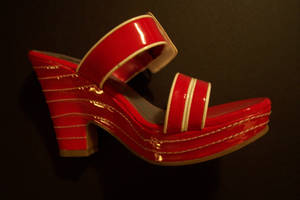 Left red shoe
