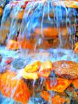 Orange Rocks in Bright Water