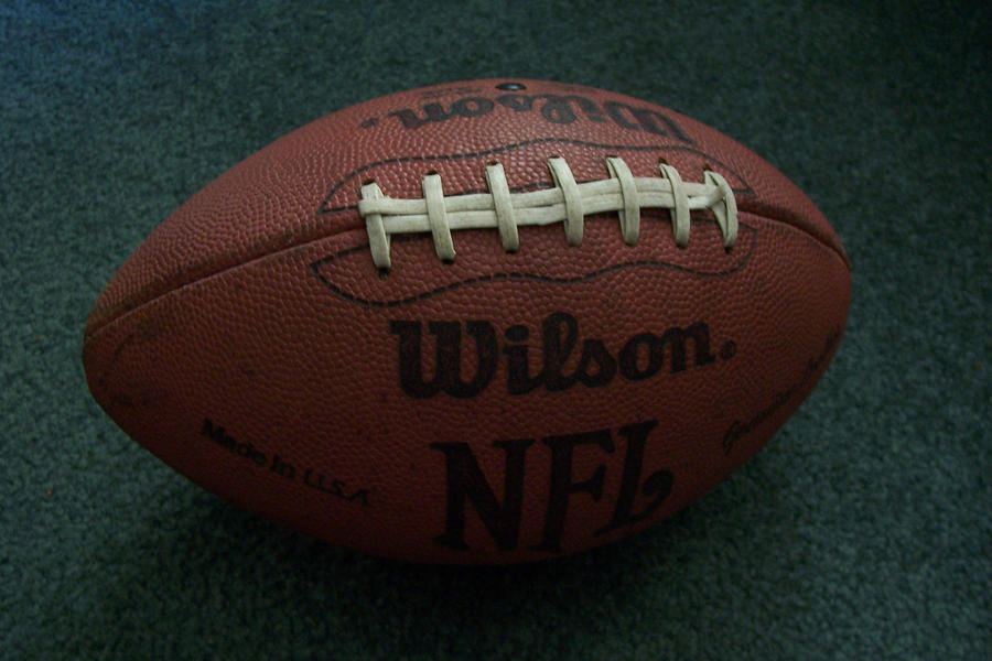 Side View of Football NFL by paintresseye