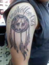 Navy Wolf Arts tattoo