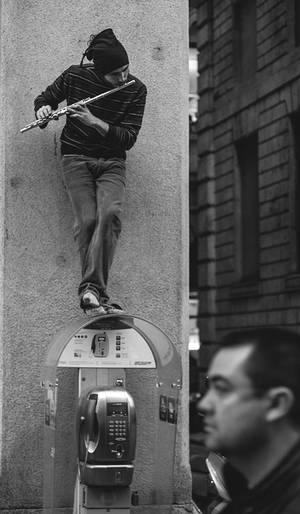 Milano street musician by Lastavica13