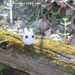 Chibi Totoro on a mossy log by Npantz22