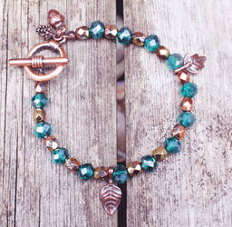 Green and Gold Beaded Bracelet with Nature Charms by dimebagsdarrell