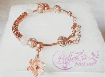 Rose Gold plated Bracelet with Flower Charms by dimebagsdarrell