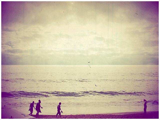 along miles of sandy beach by imignacio